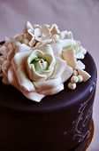 pic of sugar paste  - Gorgeous birthday cake covered with black fondant and decorated with white sugar paste flowers - JPG