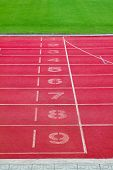 pic of olympiad  - Starting line of Running lane in sport stadium - JPG
