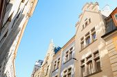 stock photo of tourist-spot  - Buildings exteriors with sunlight spots in perspective - JPG
