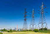 foto of electricity pylon  - Electricity pylons with blue sky on the background - JPG