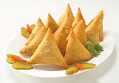 stock photo of samosa  - Potato Samosa filled with spicy potato filling - JPG