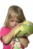 pic of pouty lips  - A baby crying with a pillow in hands - JPG
