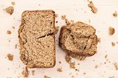 pic of whole-grain  - whole grain buckwheat bread on white wooden background  - JPG