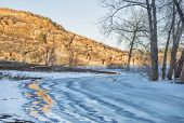 stock photo of horsetooth reservoir  - sandstone cliff and frozen lake  - JPG