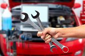 picture of auto garage  - Hand of car mechanic with wrench - JPG