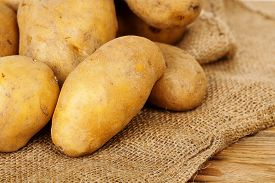 pic of potato-field  - heap of fresh potatoes on burlap sack