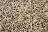 picture of tile  - Floor tiles paved with pebbles and stone tiles of different sizes and color - JPG