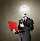 foto of light-bulb  - businessman in expensive suit with red laptop - JPG
