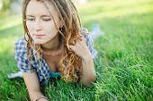 pic of dreadlock  - Young stylish girl with dreadlocks outdoors - JPG