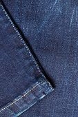stock photo of denim jeans  - closeup detail of blue denim jeans trouses texture background - JPG