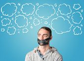 foto of taboo  - Funny person with taped mouth and hand drawn clouds around head - JPG
