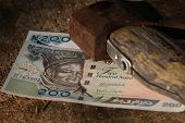 Naira Bills Under Old Axe