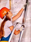 foto of millwright  - Happy working woman in builder uniform indoor - JPG