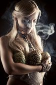 picture of woman dragon  - beautiful blond with three dragon eggs isolated on black background - JPG