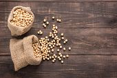 pic of soybeans  - Top view soybean on wooden background and empty space - JPG