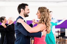 image of senior class  - Young and senior couples getting dance lessons - JPG