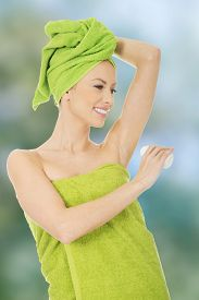 picture of deo  - Young woman wrapped in towel using deodorant - JPG
