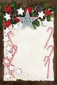 picture of candy cane border  - Christmas abstract background border with gingerbread biscuits and candy canes - JPG