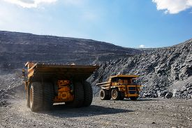 picture of iron ore  - Heavy mining truck on the iron ore opencast mining quarry - JPG