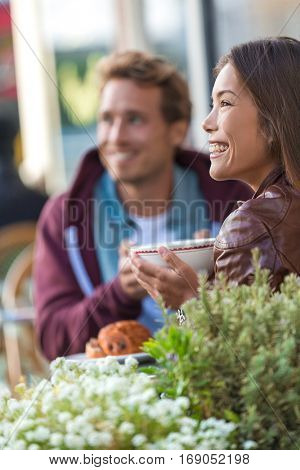Happy people eating brunch at