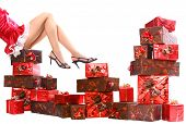 sexy young mrs. Santa with gift boxes
