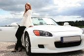 beautiful young woman with white luxury car