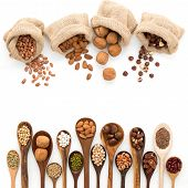Different Kind Of Beans And Lentils In Wooden Spoon On White Wood Background. Mung Bean, Groundnut, poster