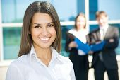 pic of beautiful women  - Beautiful woman on the background of business people - JPG