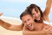 stock photo of old couple  - Couple having fun at the beach - JPG