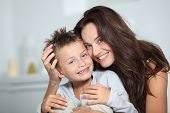 stock photo of family fun  - Mother and son having fun at home - JPG