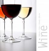 Closeup of glasses full of wine on grey background