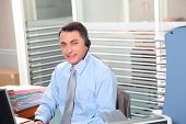 Adult man in the office talking on the phone