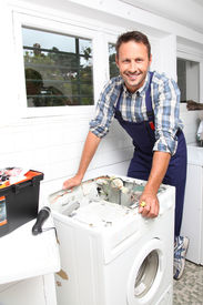 foto of washing-machine  - Plumber fixing broken washing machine - JPG