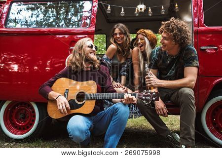 Group of excited hippies men