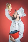 Bearded Chef With Pasta In Hand. Chef Eating Delicious Spaghetti. Cook Eat Pasta. Chief Cook Tasting poster