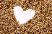 stock photo of home is where your heart is  - Unroasted coffee texture with heart - JPG