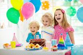 Kids Birthday Party. Child Blowing Out Cake Candle poster