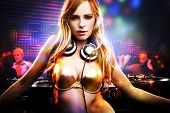 Beautiful DJ girl standing in the front of the decks