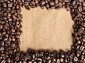 coffee beans border on the sack background