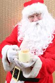 Santa Claus. Santa Claus drinks Eggnog for Christmas. Eggnog Drink. Holiday Traditional beverage. Fo poster