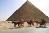 PYRAMIDS OF GIZA, EGYPT - MARCH 11: Unidentified Egyptian people offer horse ride under Great pyrami