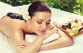 Beautiful Woman Relaxing In Spa Salon With Hot Stones  Body Massage poster