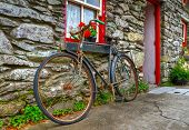 Old rusty bike at Irish cottage house