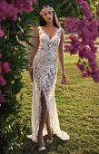 Woman In White Wedding Dress In Garden. Bride And Wedding Ceremony. Wedding Fashion And Beauty. Eleg poster