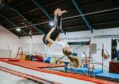 Female gymnast practicing a gymnastic poster