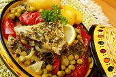 stock photo of tagine  - Moroccan fish chermoula tagine - JPG