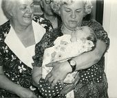 Vintage unretouched photo of two grandmothers, grandfather and baby girl