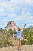 Girl exercising yoga in Uxmal, Mexico - Mayan ruins (Pyramid of Magician)