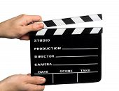 stock photo of clapper board  - image of hands holding a movie clapper - JPG