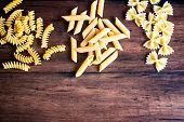 Variety Of Types And Shapes Of Dry Italian Pasta - Fusilli, Farfalle Or Bow Tie Pasta And Penne, Top poster